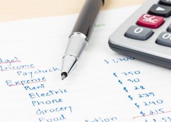 a_budgeting_guide_hoek_modular_homes_handwritten_expense_list.jpg