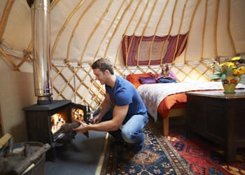 glamping_hoek_modular_homes_gentleman_lighting_fireplace.jpg